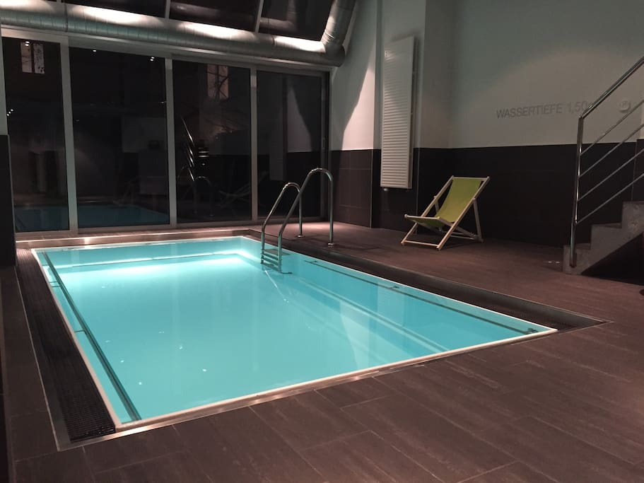 heated indoor swimming pool with upstream swimming for a fast workout, relaxing rainshowers, beach chairs, relaxing area
