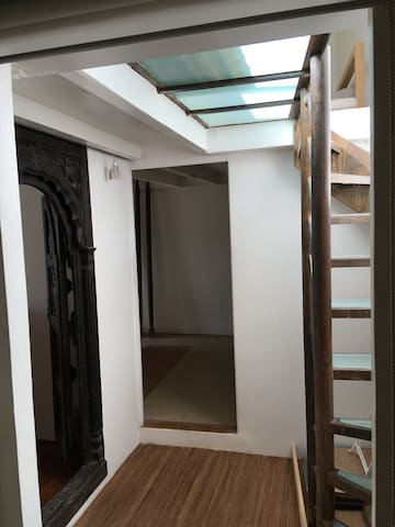 Landing on 6th floor with narrow steps going to roof top garden and mezzanine