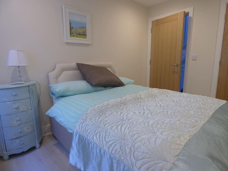 Double bed with en suite shower room