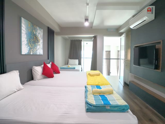 There are 1 king size bed and 2 super single beds at the master bedroom at mezzanine floor.  All of our bedrooms are fully air conditioned.