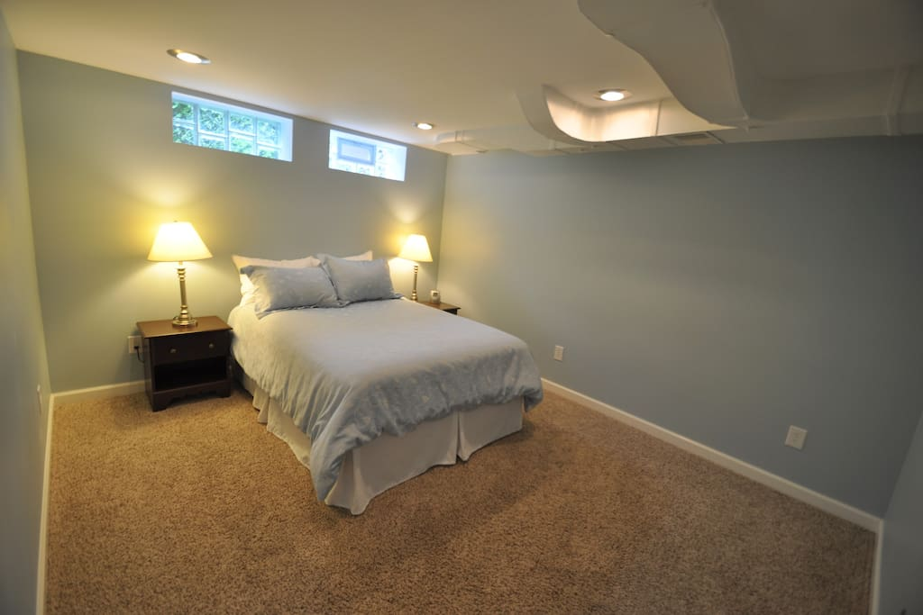 Private bedroom with closet and queen bed.
