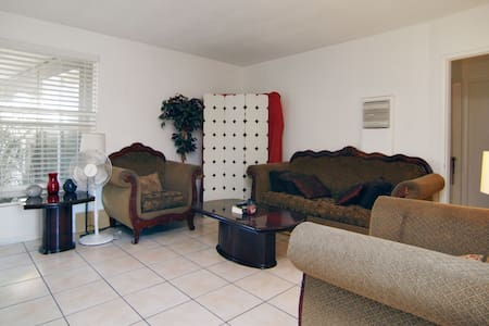 Cool tile floors throughout, granite counter tops,  classy furniture. Close to everything interesting about L.A. Located a block away from the Culver City Train Station, a block from the 10 frwy and a 15 minute drive to Santa Monica Beach. No Stove.