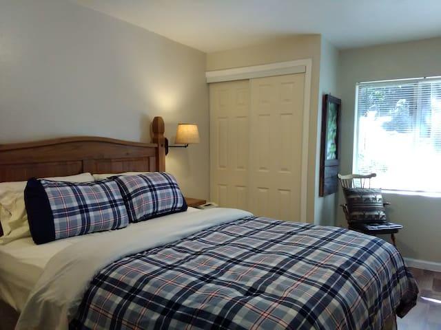 Bedroom - Queen bed, extra seating, murphy desk