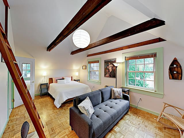 Wood-beam ceilings and a plush sofa can be found in the light-filled living area.
