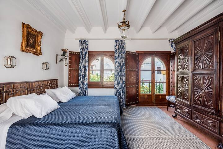 Main or blue room. King bed or two individuals beds.