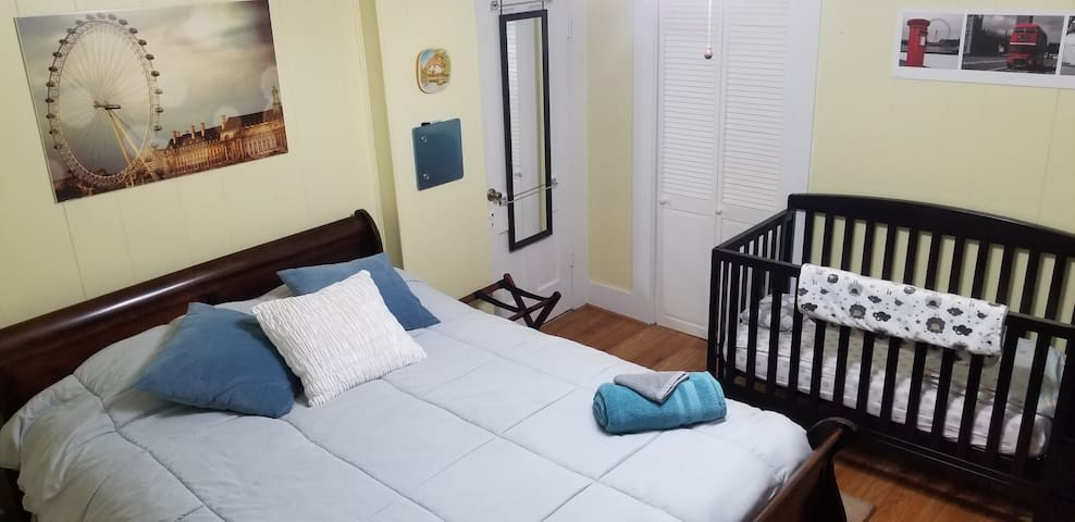 Bedroom 2 from NE corner. Baby crib (Berkley 4-in-1 Convertible Crib and Changer) has three height adjustments on the mattress and can convert to a toddler bed by removing front gate.  Tools are in changing table drawer.