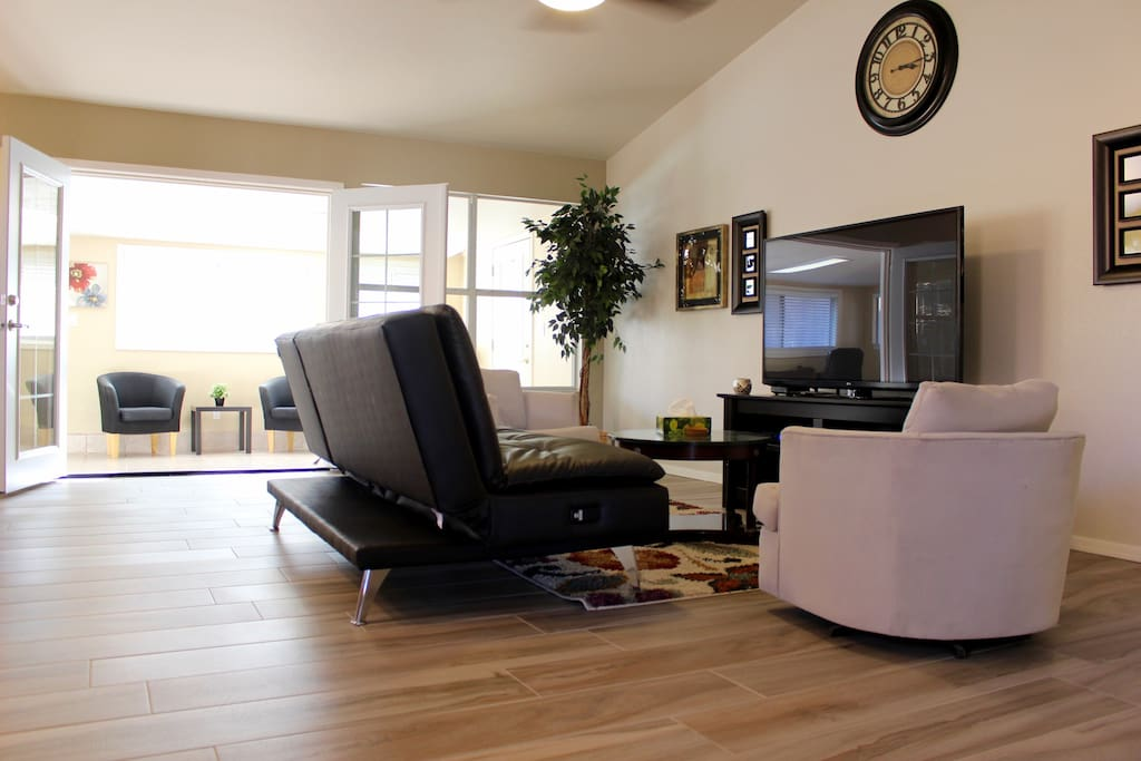 The family room is a part of the shared areas. Has a 65 inch LG HDTV complete with cable.