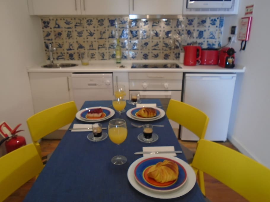 Large kitchen with a wooden solid table for six.