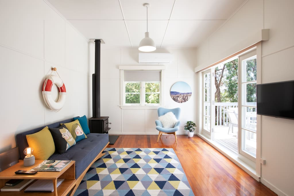 Lounge with polished Matai floors and French doors opening out to a good-sized deck for Alfresco dining.
