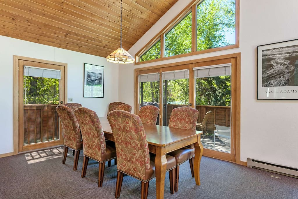 Views of the wrap around deck from the dining table with seating for 8 guests.