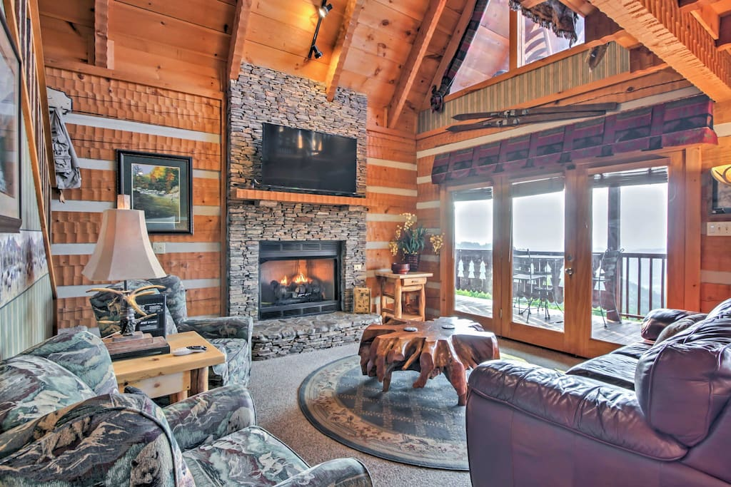 The 2,400-square-foot cabin is nestled on a hillside and features gorgeous interior and exterior views, along with top-notch amenities.
