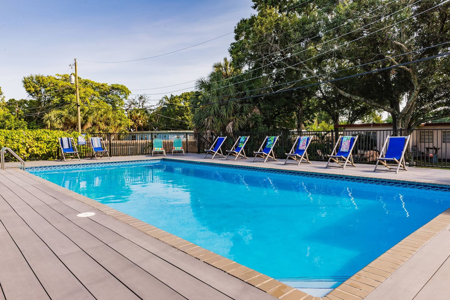 Relax in the salt water pool.  It has no chlorine and is very good for the skin.  Very large at 20x40 feet (6 x 12m).  Depth ranges from 3.5 to 7 feet (1.1 to 2.15m).  Shared by eight units around a common back yard.