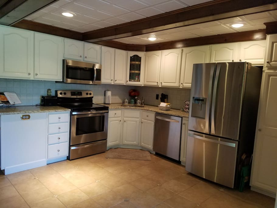 Large fully-equipped kitchen now with stainless steel appliances