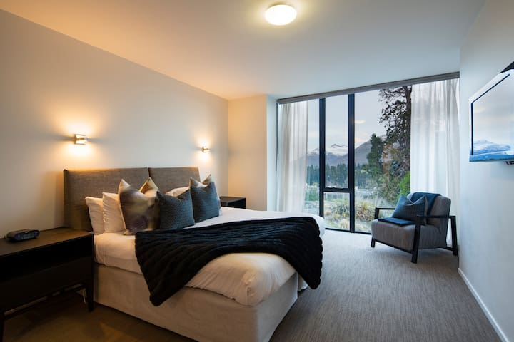 The master bedroom also enjoys a view over the bush and lake. Stunning at night when the stars are out. Also has private ensuite bathroom.