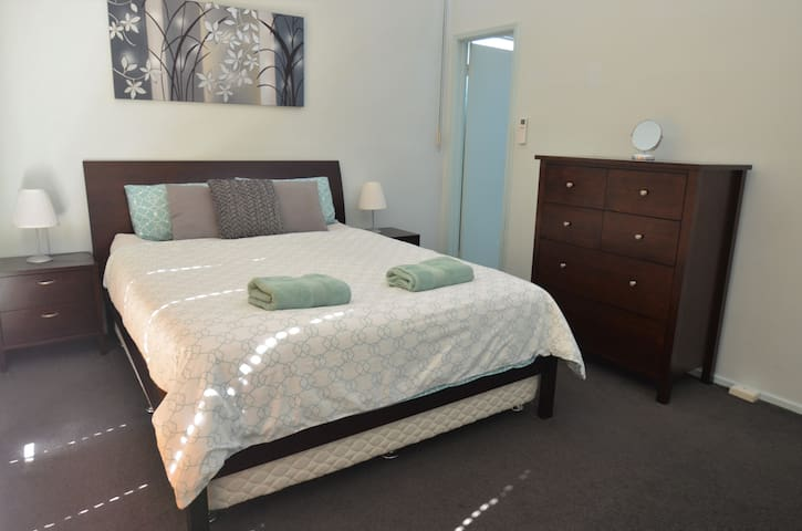 Master bedroom with ensuite bathroom in Richmond