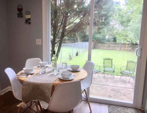 Take in the view of the large back yard while dining