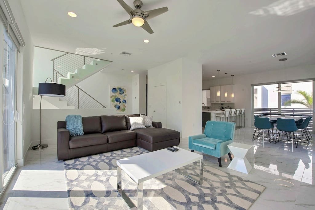 After a day in the Florida sun, chill in the main living room with contemporary furniture