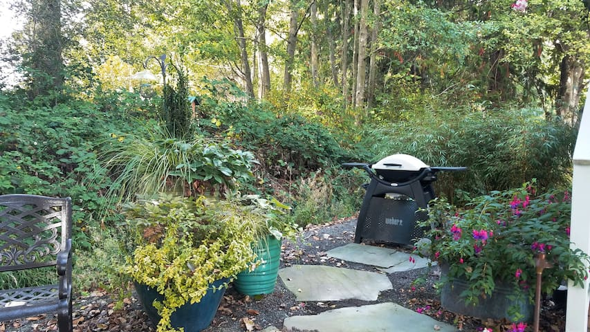 A Weber gas grill completes the patio.