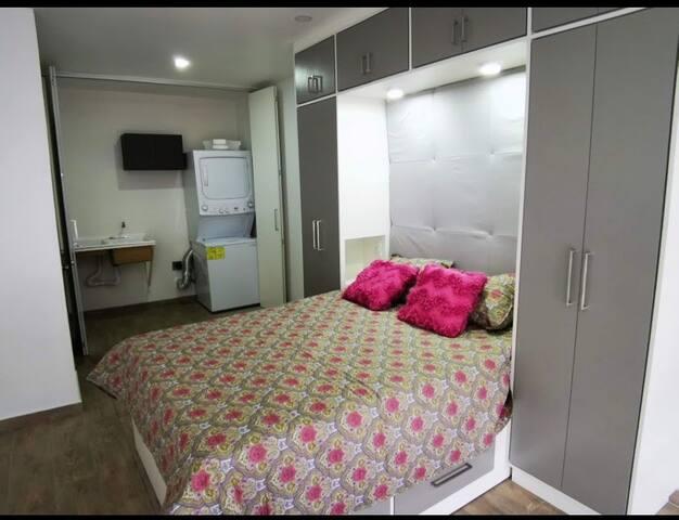 Habitación y zona de lavado
