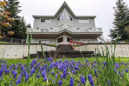 Bright getaway w/ waterviews, private hot tub, and location blocks to beach!