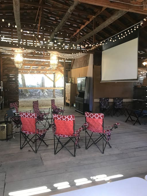 "The gathering space in the barn is expanded with the ""party port"" which extends just outside the whole width of the barn  40'x12'.  No need to worry about the rain spoiling your event."