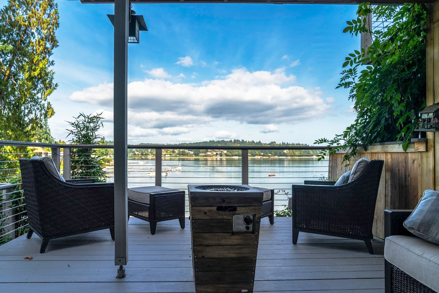 Hanging directly over the water's edge! 180 degree view! See eagles, seals, otters and even whales on occaision! Propane fire column on deck, gated 4.5 acres, extensive lawns, 10 kayaks, rowboat, and canoe all included!