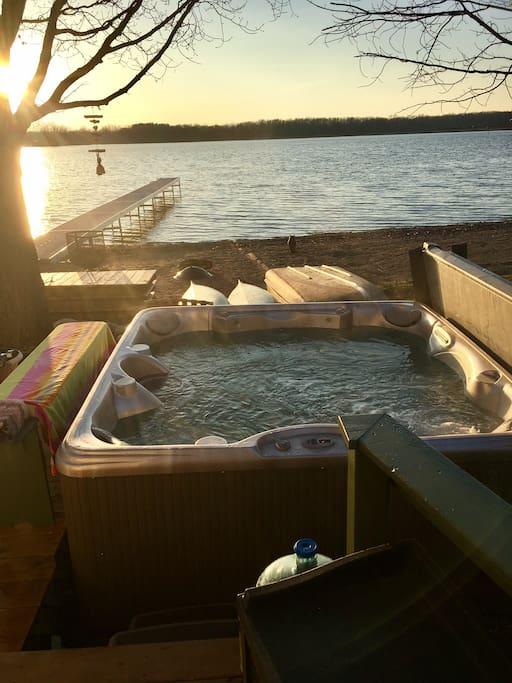 Outdoor hot tub off deck facing the lake