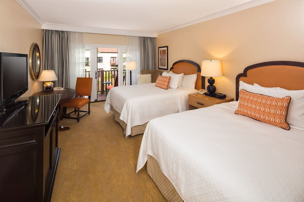 Relax in the luxurious queen beds after a day at the beach.