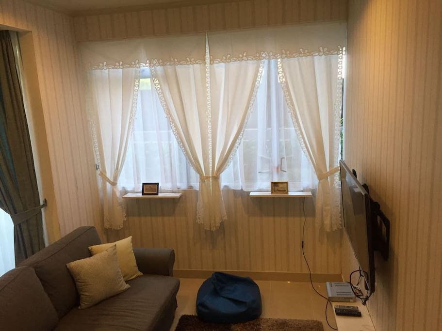 Big windows with a sweet touch of the curtain