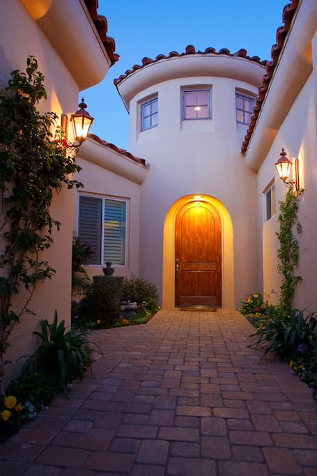 Gated entry past Casita to dramatic foyer