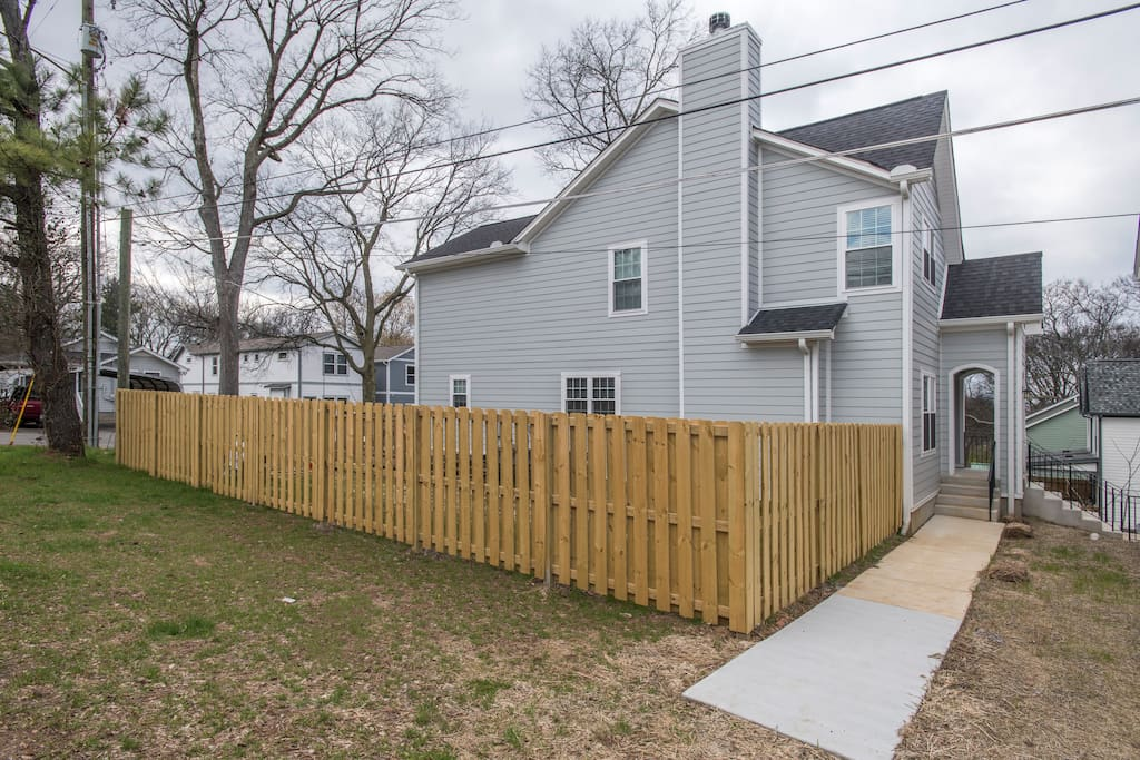 Side of house with fenced in yard