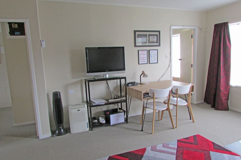 TV, info sheets and table/desk for two