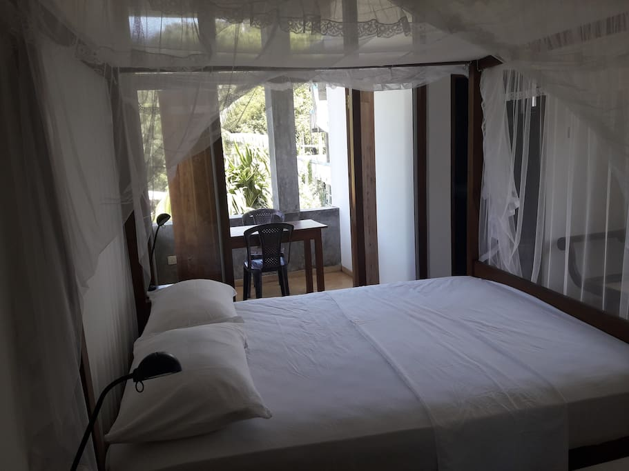 Room 3 has a queen size double bed. The room also has a balcony overlooking the nearby Rumasala mountain.
