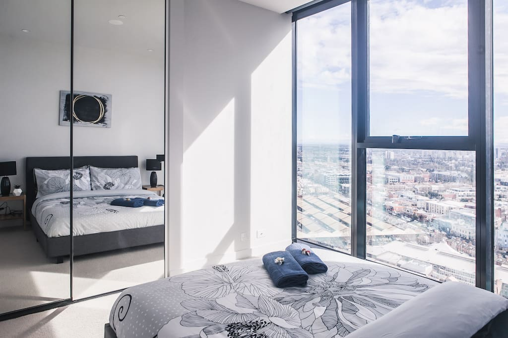 Spacious bedroom with city facing