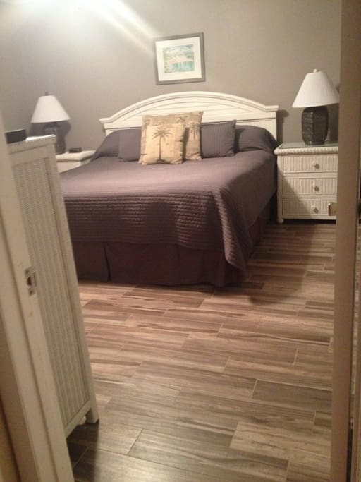 Master bedroom, tile floor and king size bed