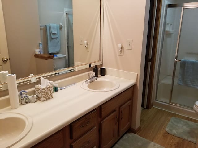 Private bathroom with shower & double vanity.