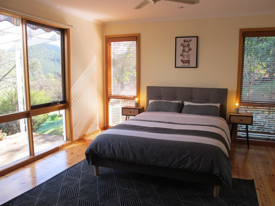 Sunny master bedroom with beautiful views
