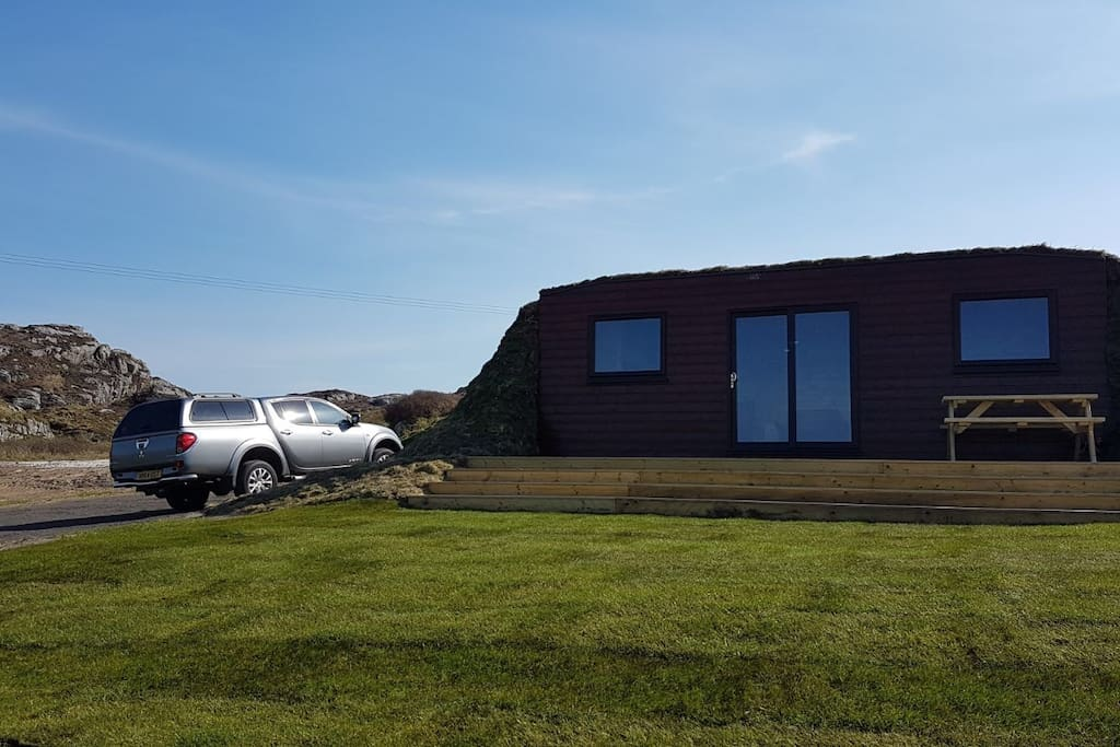 Our Storm-Pod with parking, decking and picnic bench to enjoy the views