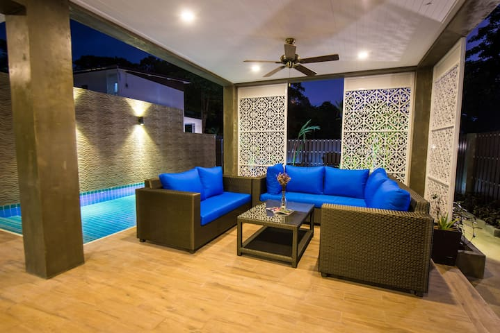 Comfy poolside sofas, perfect for lounging