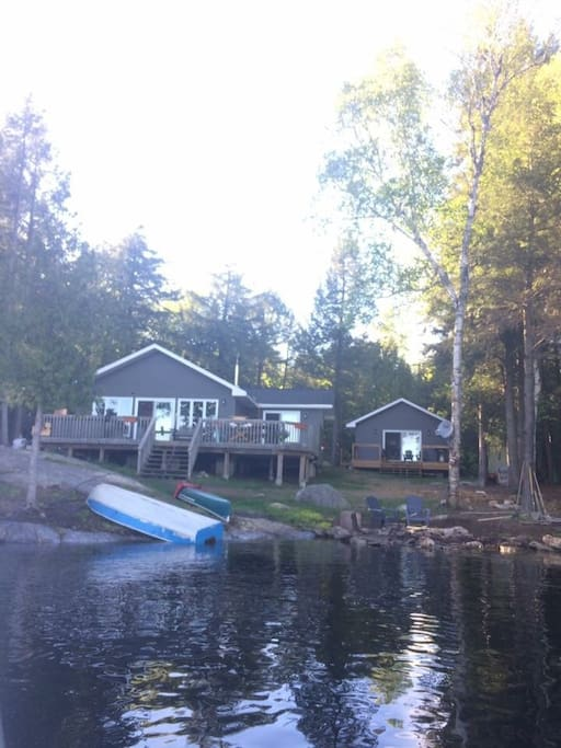 View of property from the lake. Large main cottage (1500 square feet with open concept living, dining and kitchen area) and guest cabin (480 square feet of luxury!) 112 feet of waterfront!