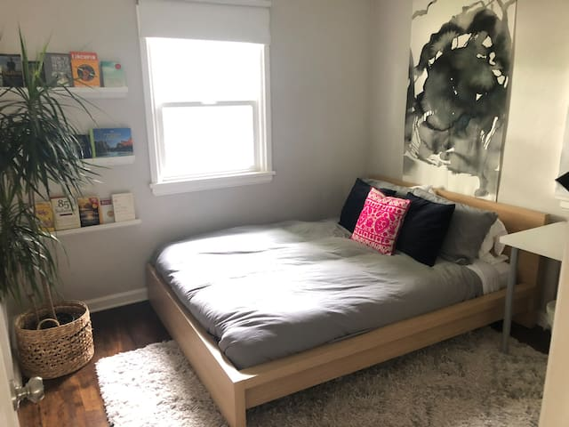 Bedroom #2 with comfortably queen sized bed and a desk