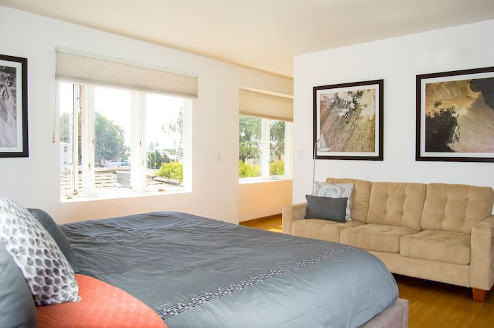 Master bedroom with views, kind size bed and en suite bathroom