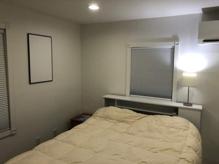 Cozy room with Queen Bed, own thermostat, and more