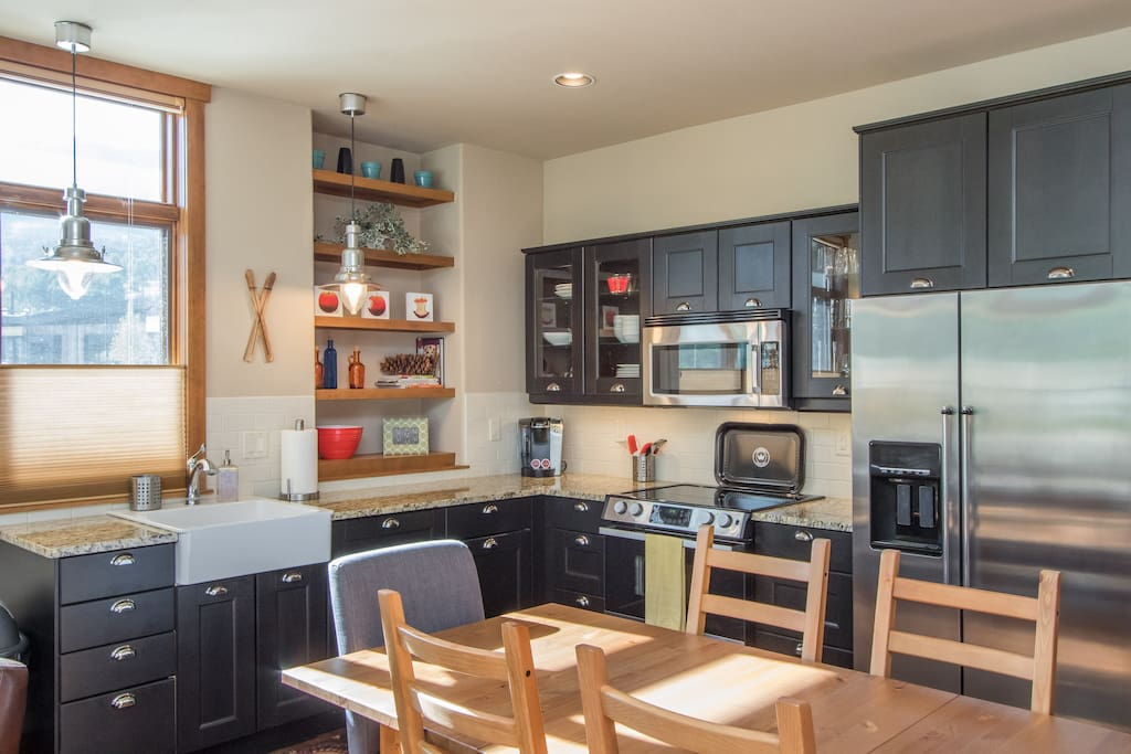 Kitchen includes full-size stovetop, oven, fridge, microwave, and dishwasher.