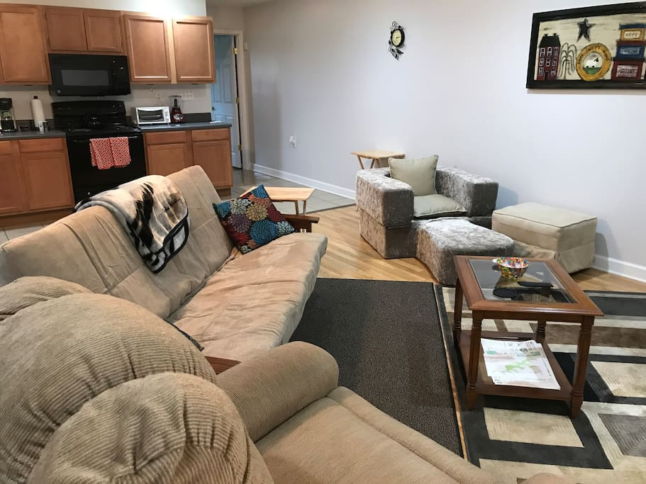 The large open room contains the living room and kitchen/dining area. There are plenty of brochures of activities in the area.