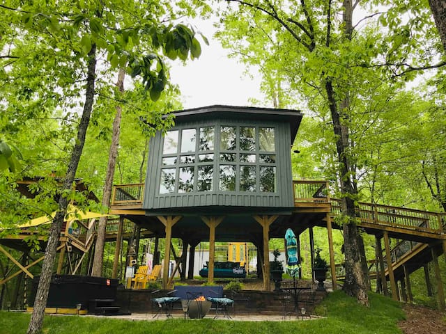 Front view of window wall that is twenty two feet in length and twelve feet in height! Overlooks the patio with fire pit and hot tub!