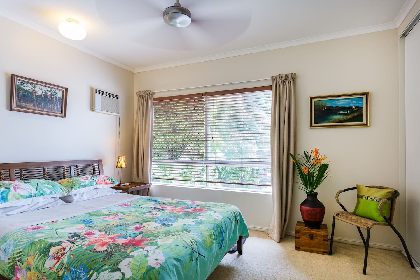 Queen size bed in main bedroom. Bright and Airy but with Blockout Curtains if needed. Plenty of wardrobe space and hangers. Small TV. Box Aircon.