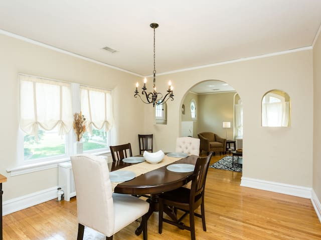 Formal dining room with espresso-stained dining table with optional leaf extension and seating for 6