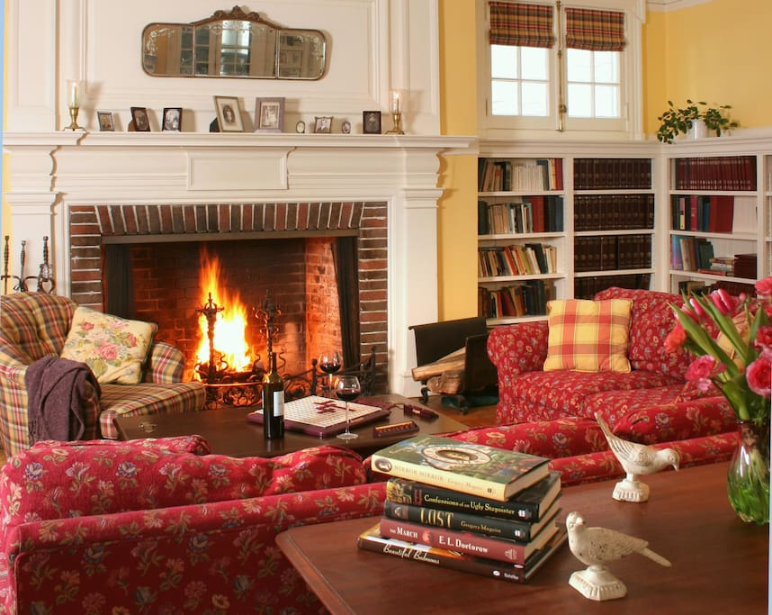 Comfortably elegant library with wood-burning fireplace.