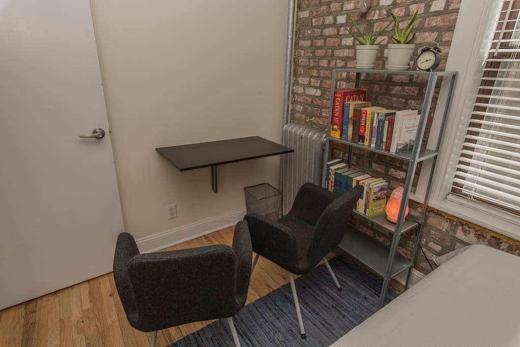 Desk unfolds from the wall for workspace or breakfast nook.
